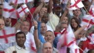 MS PAN Spectators in bleachers waving English flags, London, UK