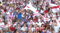 WS Spectators in bleachers waving English flags, London, UK