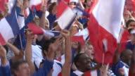 MS Spectators in bleachers waving French flags, London, UK