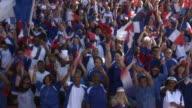 WS Spectators in bleachers waving French flags, London, UK