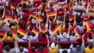 WS HA Spectators in bleachers waving German flags, London, UK