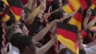 CU PAN Spectators in bleachers waving German flags, London, UK