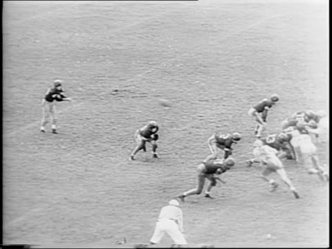 Spectators in stands / montage of game play cheering fans / players include Kermit L Atkinson Otto E Graham James W Pettit Robert T Jenkins Joseph J...
