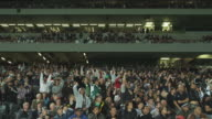MS Spectators stand and cheer during game at Eden Park Stadium / Auckland, New Zealand
