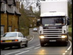 Speed camera trial SIDE Man working at computer CS Hands operating mouse Halstone Truck towards along winding village lane i/c next speed camera GVs...