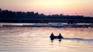 Speedboat and river in sunset
