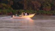 speeding boat on Cuiaba River in search of Jaguars, Pantanal, Brazil
