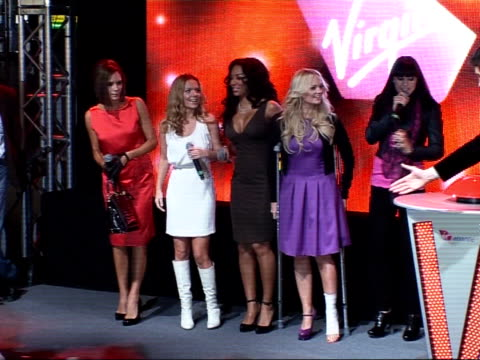 Spice Girls press conference / Richard Branson interview Kay introducing Spice Girls on stage SOT **some very shaky camera*** Spice Girls on to stage...