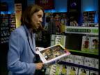 London Int Spice Girls merchandise piled on table i/c Gennaro Castaldo intvw How Geri's departure will affect sales Displays TILT DOWN 'Spice World...