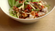 spicy squid with salad
