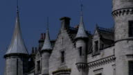 Spires and neat rows of windows characterize Dunrobin Castle in Sutherland, Scotland. Available in HD.