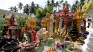 Spirit houses with offerings