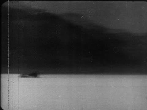 VS 'Spirit of America' jet propelled car traveling at high speeds across Bonneville Salt Flats driver Craig Breedlove in cockpit w/ helmet goggles...