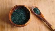 Spirulina Algae Flakes in Wooden Bowl & Spoon