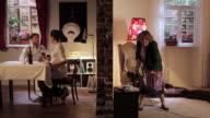 WS Split screen showing  senior woman playing guitar and irritating her neighbors / Berlin, Germany