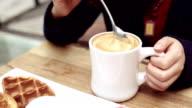 Spoon stirring coffee