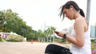 Sport woman using phone after work out