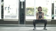 Sport woman work out with dumbbell in gym