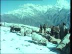 Changabang expedition INDIA Himalayas TS Sherpas at lorry at base Camp BV Sherpa carries sack LMS Chris Bonnington drinks hands to Indian leader MS...