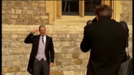 Sports stars receive honours at Windsor Castle Andrew Strauss posing for photocall as holding up OBE medal / Strauss with his wife / Andrew Strauss...