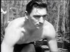 1947 MONTAGE sportsman wrestling alligator / Okefenokee Swamp, Georgia, United States