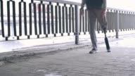 Sporty man with prosthetic leg running outside