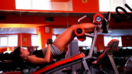 Sporty woman in the gym
