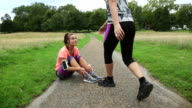 Sporty women motivate her friend and go