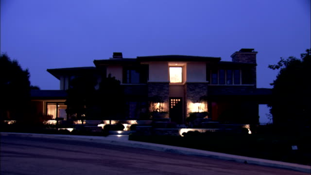 Spotlights on exterior of luxury home in Los Angeles Available in HD.