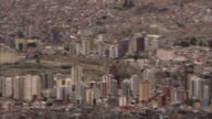 A sprawling city sits in a Bolivian valley. Available in HD.