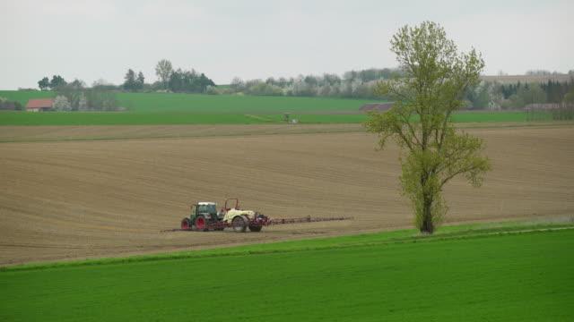 Spraying Crop Field In Springtime (4K/UHD)