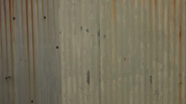 Spraying 'Hate' in Graffiti on glass