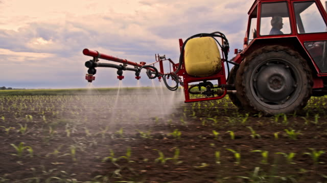Spraying pesticides on a field