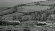 1969 PAN Spring landscape of green hills and valleys / Devon, England, United Kingdom