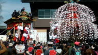 Spring was in the air as decorated floats and a parasollike display of cascading flowers set off from Tsunemochijinja shrine in Chichibu Saitama...