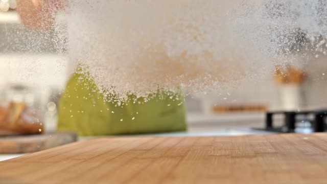 SLO MO LD Sprinkling flour over the cutting board