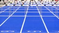 Sprint Hurdle Race For Men On Blue Track