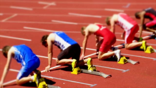 SLO MO Sprinters Pushing Off Of The Starting Block