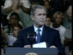 Crew arrive home POOL USA Washington DC President George W Bush standing on podium waving to crowds of supporters US President George W Bush speech...