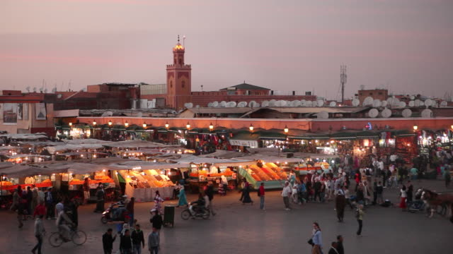 Square called Djemaa El Fna at dusk. Food and fruit stalls, Marrakech, Morocco