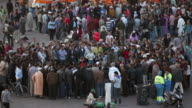 Square called Djemaa El Fna. Girl challenges boys for boxing game, Marrakech, Morocco