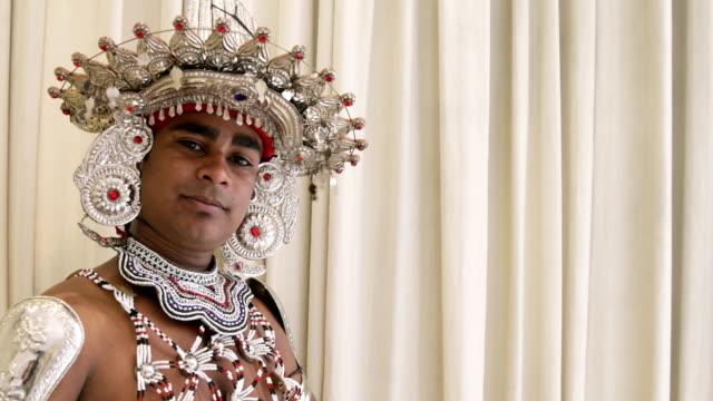 Sri Lankan male dancer close up poses