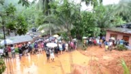 Sri Lankan military rescue workers and villagers searched for survivors at the site of a mudslide in Bellana village in Kalutara on May 26 2017