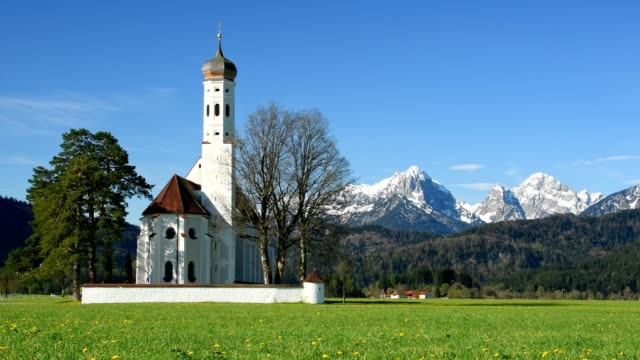 St. Coloman Church with mountains in spring, Schwangau, Fuessen, Allgau, Bavaria, Germany