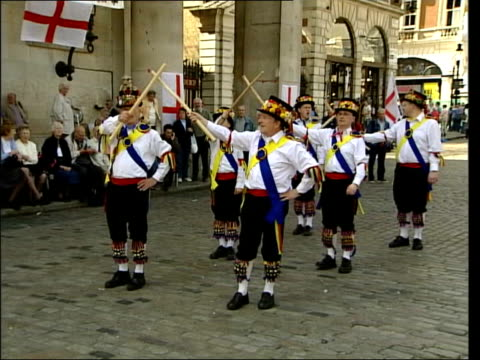 St George's Day English national pride ITN London Covent Garden GV Group of Morris dancers performing during St George's Day celebrations ZOOM IN