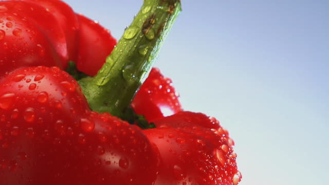 CU, TU, Stack of bell peppers with water droplets rotating