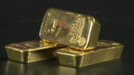 CU Stack of gold ingots spinning / Hanau, Hessen, Germany