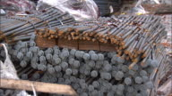 MS Stacked steel rods rebarb varying sizes bound together