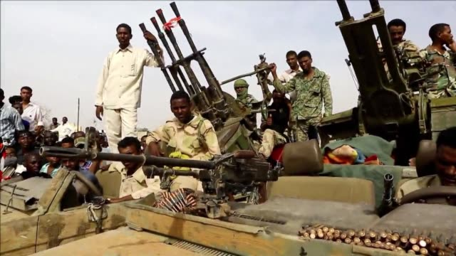 Stacked with rockets and machineguns dozens of trucks seized from rebels lined the main square of South Darfur's state capital
