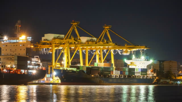 TL: stacking container into industry ship at night